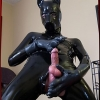 Full body latex puppy suit looks amazing on alluring t-girl Jamie French